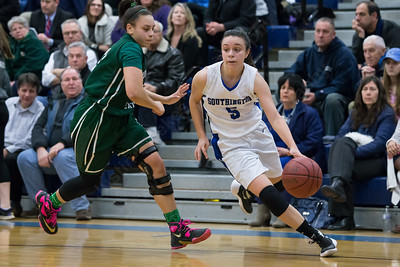 Southington's Margaret Meehan gets past Northwest Catholic's Elizabeth Jacobs Monday at Southington High School in Southington Jan. 25, 2016 | Justin Weekes / For the Record-Journal