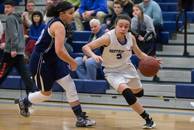 Southington's Margaret Meehan drives past Middletown's Silvana Barcomb  Thursday during first round play in the CCC tournament at Southington High School in Southington Feb. 18, 2016 | Justin Weekes / For the Record-Journal