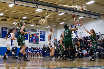 Southington's Margaret Meehan gets a running one handed shot off in the lane Monday at Southington High School in Southington Jan. 25, 2016 | Justin Weekes / For the Record-Journal