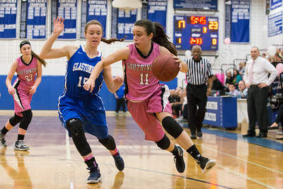 Southington's Margaret Meehan looks to cut baseline on Glastonbury's Christina Semevolos  Friday at Southington High School in Southington Jan. 29, 2016 | Justin Weekes / For the Record-Journal
