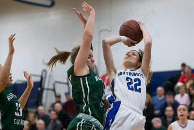 Southington's Hartlee Meier gets a shot off as Northwest Catholic's Mackenzie Tibball defends Monday at Southington High School in Southington Jan. 25, 2016 | Justin Weekes / For the Record-Journal