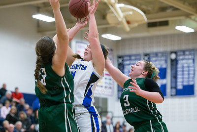Southington's Diana Verderame gets position inside as Northwest Catholic's Anna Cenci and Erin Feeney defend Monday at Southington High School in Southington Jan. 25, 2016 | Justin Weekes / For the Record-Journal