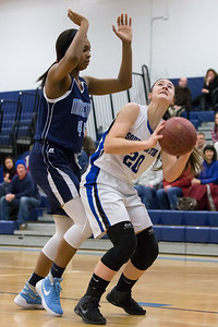 Southington's Natalie Wadolowski works the low post on Middletown's Brielle Wilborn Thursday during first round play in the CCC tournament at Southington High School in Southington Feb. 18, 2016 | Justin Weekes / For the Record-Journal