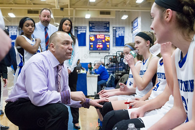 Southington's head coach  Mike Forgione talks with players at the end of the  third quarter with Northwest Catholic Monday at Southington High School in Southington Jan. 25, 2016 | Justin Weekes / For the Record-Journal