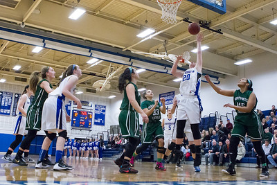 Southington's Natalie Wadolowski puts back a rebound for two Monday at Southington High School in Southington Jan. 25, 2016 | Justin Weekes / For the Record-Journal