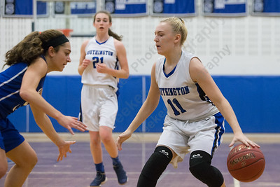 Southington's Kristen Longley looks for room to drive Thursday during the season opener at Southington High School in Southington December 14, 2017 | Justin Weekes / For the Record-Journal