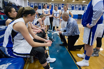 Southington's head coach Mike Forgione talks with players Thursday during the season opener at Southington High School in Southington December 14, 2017 | Justin Weekes / For the Record-Journal