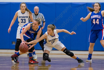 Southington's Allison Carr reaches for the steal from Plainville's Caitlin Barker Tuesday at Southington High School in Southington January 2, 2018 | Justin Weekes / Special to the Record-Journal