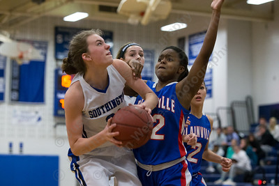 Southington's Madison Hulten looks to put back a rebound Tuesday at Southington High School in Southington January 2, 2018 | Justin Weekes / Special to the Record-Journal