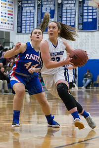 Southington's Janette Wadolowski drives past Plainville's Krystyna Miller Tuesday at Southington High School in Southington January 2, 2018 | Justin Weekes / Special to the Record-Journal