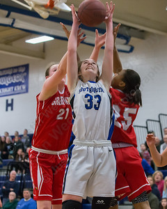 Southington's Janette Wadolowski gets position on Greenwich's Abigail Wolf  (21) and Jayla Faison (25) Thursday at Southington High School in Southington  Mar. 3, 2016 | Justin Weekes / For the Record-Journal