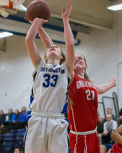 Southington's Janette Wadolowski gets the put back on Greenwich's Abigail Wolf  (21) Thursday at Southington High School in Southington  Mar. 3, 2016 | Justin Weekes / For the Record-Journal