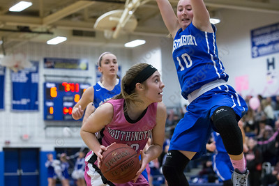 Southington's Janette Wadolowski works the low post on Glastonbury's Hayley Newhouse Friday at Southington High School in Southington Jan. 29, 2016 | Justin Weekes / For the Record-Journal