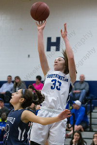 Southington's Janette Wadolowski (33) hits a jumper over Wethersfield's Juliana Mandile (23) Saturday at Southington High School in Southington Jan. 16, 2016 | Justin Weekes / For the Record-Journal