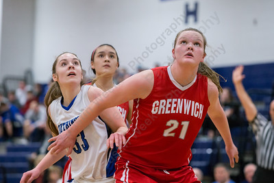 Southington's Janette Wadolowski tries to get position on Greenwich's Abigail Wolf Thursday at Southington High School in Southington  Mar. 3, 2016 | Justin Weekes / For the Record-Journal