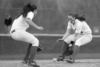Southington's Janette Wadolowski  rushes a ground ball from Fitch's Nicole Vignato Monday at Southington High School in Southington Apr. 25, 2016 | Justin Weekes / For the Record-Journal