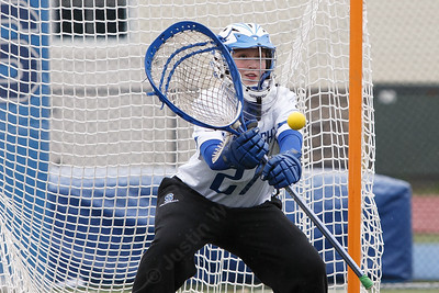 Southington's Julia Wells stops a shot Thursday at Southington High School in Southington April 19, 2018 | Justin Weekes / Special to the Record-Journal