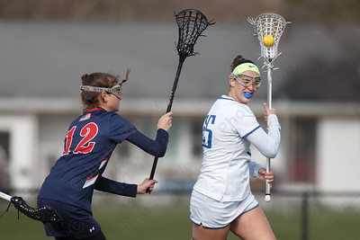 Southington's Molly Dobratz works past a defender Thursday at Southington High School in Southington April 19, 2018 | Justin Weekes / Special to the Record-Journal