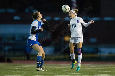 Southington's Melissa Drexler wins a header Tuesday during first round play in the Class LL CIAC tournament at Fontana Field in Southington November 7, 2017   Justin Weekes / For the Record-Journal