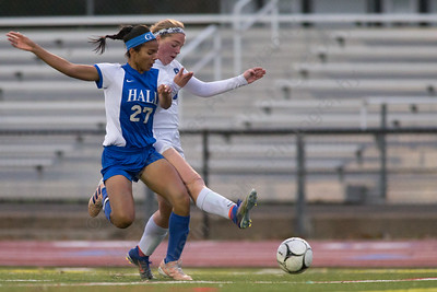 Southington's Natalie Verderame is challenged by Hall's Giovanna Dionicio Tuesday during first round play in the Class LL CIAC tournament at Fontana Field in Southington November 7, 2017   Justin Weekes / For the Record-Journal