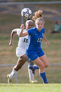 Southington's Natalie Verderame chases down a loose ball Friday at Platt High School in Meriden October 6, 2017   Justin Weekes / For the Record-Journal