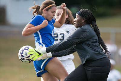 Platt's keeper Sar'ja Jenkins comes out to stop a shot Friday at Platt High School in Meriden October 6, 2017   Justin Weekes / For the Record-Journal