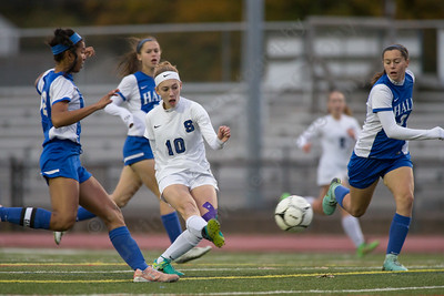 Southington's Melissa Drexler gets a shot off scoring putting the Blue Knights up 1 to 0 Tuesday during first round play in the Class LL CIAC tournament at Fontana Field in Southington November 7, 2017   Justin Weekes / For the Record-Journal