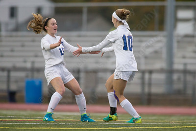 Southington's Melissa Drexler (10) and Kelly Doyle celebrate after scoring Tuesday during first round play in the Class LL CIAC tournament at Fontana Field in Southington November 7, 2017 | Justin Weekes / For the Record-Journal