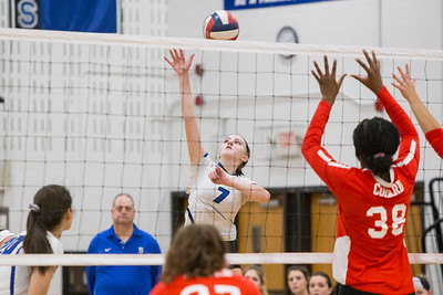 Southington's Haley Larrabee cuts a spike past blockers Saturday during the CIAC Class LL quarterfinals at Southington High School in Southington November 10, 2018   Justin Weekes / Special to the Record-Journal
