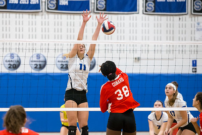 Southington's Veronika Gorski jumps to block Conard's Fely Yigle-Kaljob Saturday during the CIAC Class LL quarterfinals at Southington High School in Southington November 10, 2018   Justin Weekes / Special to the Record-Journal