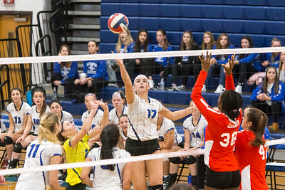 Southington's Brooke Cooney plays a touch over Conard's blockers Saturday during the CIAC Class LL quarterfinals at Southington High School in Southington November 10, 2018   Justin Weekes / Special to the Record-Journal