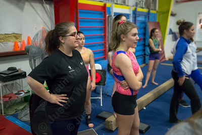 Southington's new head coach Kim Vaillancourt watches her team practice balance beam Wednesday during practice at American Gymnastic Training Center in Plantsville  January 10, 2018 | Justin Weekes / Special to the Record-Journal