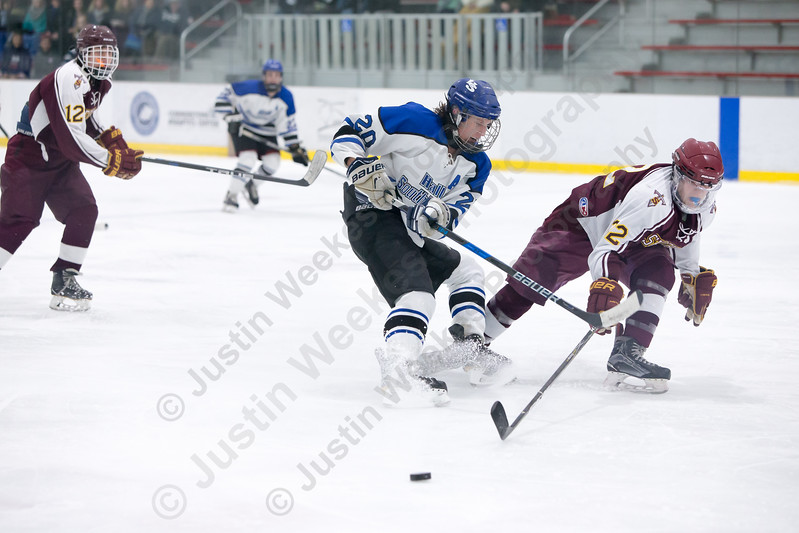 Sheehan's Nick Gonsalves stops Hall-Southington's Brendan Moore Monday at Veterans Memorial Rink in West Hartford February 26, 2018 | Justin Weekes / Special to the Record-Journal