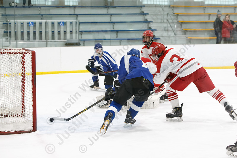 Hall-Southington's Mike DiPietro puts in a rebound Tuesday during first round play in the CIAC D-II tournament at Veterans Memorial Rink in West Hartford  March 6, 2018 | Justin Weekes / Special to the Record-Journal