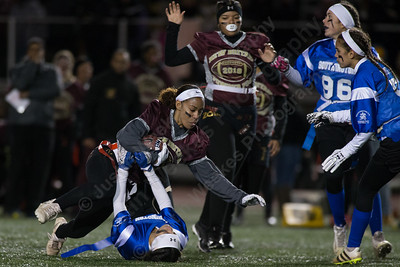 Southington's Rosalese Waskowicz stops New Britain's Jada Lawson Wednesday during the 9th Annual Powder Puff football game at Veterans Memorial Stadium in New Britain. Southington defeated New Britain 20 to 0 to make it two wins in a row. November 22, 2017 | Justin Weekes / For the Record-Journal
