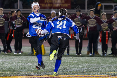 Southington's AbbyConnolly takes the reverse from Tayler Riddick Wednesday during the 9th Annual Powder Puff football game at Veterans Memorial Stadium in New Britain. Southington defeated New Britain 20 to 0 to make it two wins in a row. November 22, 2017 | Justin Weekes / For the Record-Journal