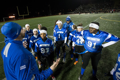Southington's coach Jon Esmail talks with the defense during a time out Wednesday during the 9th Annual Powder Puff football game at Veterans Memorial Stadium in New Britain. Southington defeated New Britain 20 to 0 to make it two wins in a row. November 22, 2017 | Justin Weekes / For the Record-Journal