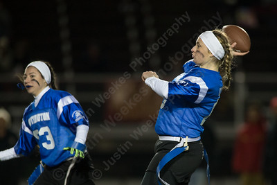 Southington's Jacqueline Coley looks for a receiver Wednesday during the 9th Annual Powder Puff football game at Veterans Memorial Stadium in New Britain. Southington defeated New Britain 20 to 0 to make it two wins in a row. November 22, 2017 | Justin Weekes / For the Record-Journal