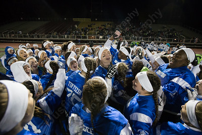 Southington's Lady Knights celebrate their win Wednesday during the 9th Annual Powder Puff football game at Veterans Memorial Stadium in New Britain. Southington defeated New Britain 20 to 0 to make it two wins in a row. November 22, 2017 | Justin Weekes / For the Record-Journal