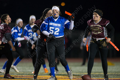Southington's Amanda Szymanski raises a flag after stopping a New Britain run Wednesday during the 9th Annual Powder Puff football game at Veterans Memorial Stadium in New Britain. Southington defeated New Britain 20 to 0 to make it two wins in a row. November 22, 2017 | Justin Weekes / For the Record-Journal