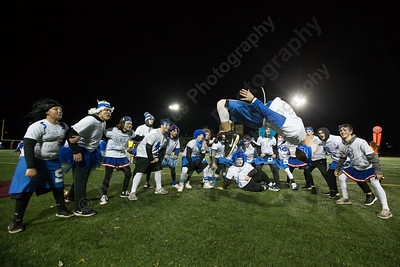 Southington's cheerleader Alex Kuhr pulls off a back flip for the crowd Wednesday during the 9th Annual Powder Puff football game at Veterans Memorial Stadium in New Britain. Southington defeated New Britain 20 to 0 to make it two wins in a row. November 22, 2017 | Justin Weekes / For the Record-Journal