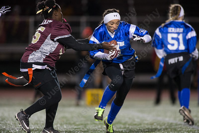 Southington's Tayler Riddick tries to avoid a tackle Wednesday during the 9th Annual Powder Puff football game at Veterans Memorial Stadium in New Britain. Southington defeated New Britain 20 to 0 to make it two wins in a row. November 22, 2017 | Justin Weekes / For the Record-Journal