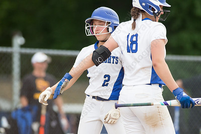 Southington's Chrissy Marotto celebrates with Kara Zazzaro after scoring the games only run Friday during the CIAC Class LL quarterfinal round at Southington High School in Southington June 1, 2018 | Justin Weekes / Special to the Record-Journal