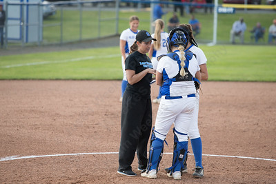 Southington's head coach Davina Hernandez talks with Kara Zazzaro and Abigail Lamson Monday during the CIAC Class LL semifinals at West Haven High School in West Haven May 31, 2016 | Justin Weekes / Special to the Record-Journal