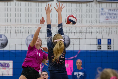 Southington's Hannah Zelina  cuts a spike past Avon's Emily Dempsey Friday at Southington High School in Southington October 13, 2017   Justin Weekes / For the Record-Journal