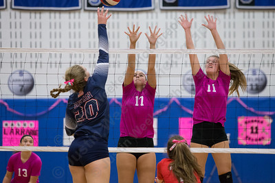 Southington's Brooke Cooney and Hannah Zelina jump to block Avon's Maddy Hart Friday at Southington High School in Southington October 13, 2017   Justin Weekes / For the Record-Journal