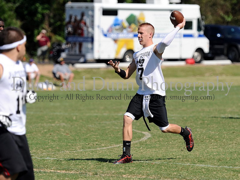 7-on-7 - Colleyville Heritage quarterback Jeff Calvert leads his team in the game against Saginaw at the Colleyville Heritage 7 on 7 Tournament Saturday, May 30th at Oak Grove Park in Grapevine.