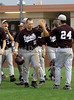 Josh Choate (#10) is congratulated after scoring in teh top of the 4th inning.
