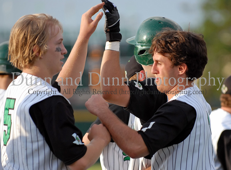 Ethan Cunningham celebrates after scoring the game winning run in the bottom of the 7th inning.