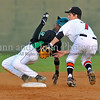 Carroll center fielder Ronnie Mitchell steals second as Colleyville infielder Ryan Schmidgall attempts to apply the tag.
